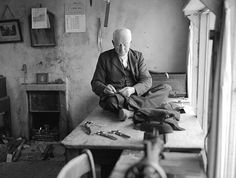 Tailor 1955 sitting in traditional pose on table