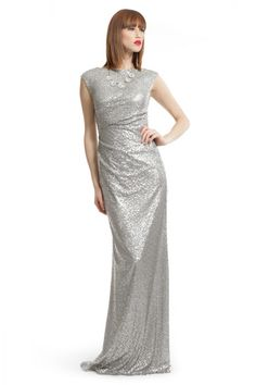 Rent this show stopping David Meister sequin gown. Heads will turn as you walk into the event and take over the dance floor. Pair with a statement necklace like the Badgley Mischka's Crystal Envy Necklace and wear a classic red lip with Lancome's Color Design Lipcolor Matte in Red Haute.