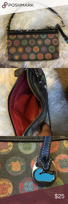 """Authentic D&B Wristlet EUC Authentic Dooney and Bourke wristlet! Approx L 7 1/2 """" H 4 1/2! Black with multi color D&B logos! Does fit an iPhone 6S Plus with a little room to spare! Perfect gift for the holidays! Dooney & Bourke Bags Clutches & Wristlets"""