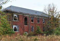 1 of dozens of decaying brick buildings at the abandoned asylum Forest Haven
