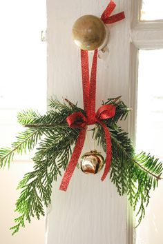 """It's never too late to decorate for the holidays. Check out this simple doorknob hanger that adds a festive """"welcome home."""""""