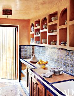 The rooftop kitchen is decorated with antique tiles | archdigest.com