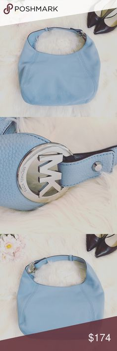 """Michael Kors Slouchy Hobo Purse New with tags, Michael Kors slouchy leather hobo in light sky with silver accents. Magnetic snap closure. Interior slip and zippered pockets. Measures 15"""" by 9"""" by 5"""" with an 8"""" strap drop. Perfect condition! Michael Kors Bags Hobos"""