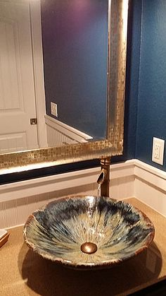 One of my Rich Cappuccino Contemporary sinks used in a client's bathroom.