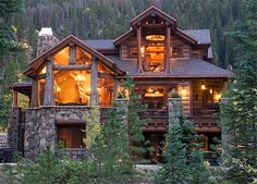 Custom Log Homes and Glass Forests---love the combo of the river rock and wood....totally gorgeous