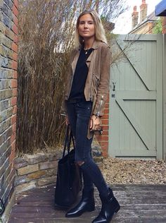 Tan suede jacket + black T-shirt + faded black jeans + flat boots