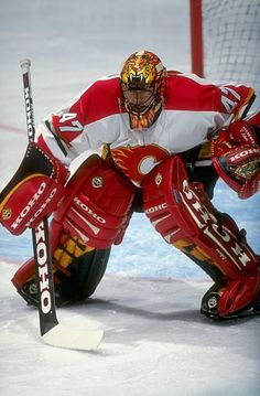 Goalie Jean Sebastian Giguere of the Calgary Flames gets ready during the game against the Chicago Blackhawks at the Canadian Airlines Saddledome in. Ice Hockey Teams, Hockey Goalie, Hockey Games, Hockey Players, Hockey Stuff, Flame Picture, Goalie Pads, Canadian Airlines, Masked Man