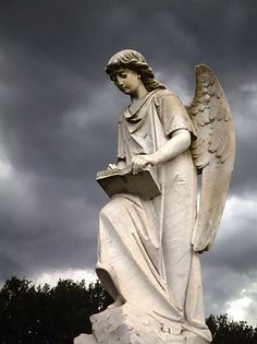 The Turning Angel  Natchez, Mississippi  - There is a statue of an angel at the front of the cemetery that, as you approach from a particular angle, appears to turn to greet you. This has been the subject of Natchez legend throughout the years... but the thing about it is, this legend is true.