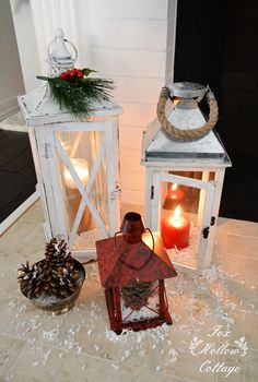 Greenery, Pinecones, Red Candles and Faux Snow Take Everyday @homegoods Lanterns Straight Into Christmas For Easy Decorating! Love them layered on my mantel for a cozy holiday glow! View more of our cottage at Christmas at foxhollowcottage.com sponsored pin.