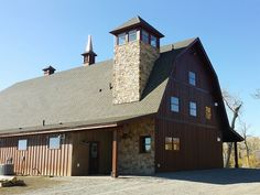Barn Pros Ayrshire gambrel barn model wrapped in stone. #beautiful #montana #wood #horse