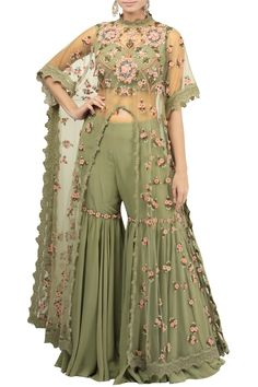 Olive sheer cape with sharara Featuring an olive sheer cape front slit cape crafted in tulle with hand thread embroidery with dabka enhanced with crystal detailing. It comes along with a pair of matching sharara pants. Party Wear Indian Dresses, Designer Party Wear Dresses, Indian Gowns Dresses, Indian Bridal Outfits, Dress Indian Style, Indian Fashion Dresses, Indian Designer Outfits, Girls Fashion Clothes, Indian Fashion Trends