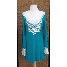 Ladies Tunic with Crotcheted accents - This cute tunic features beautiful embroidery. Pair it with your favorite jeans or leggings to create an easy outfit.