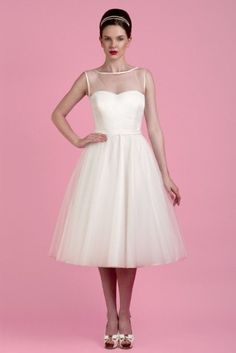 Tea length wedding dresses are some of the most popular styles for brides who want to make a real statement on their big day. Retro tea length and ballet lengths are perfect for showing a pop of personality through brightly coloured shoes and provide just the right amount of classic glamour without going overboard on vintage. The styles we've chosen for 2014 brides include beautifully full skirted dresses, and some more understated pencils skirts, but all bring the tea length dress right up…