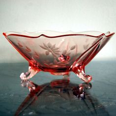 Stunning pink depression glass footed bowl was made by Lancaster Glass Company between 1926 and 1937.