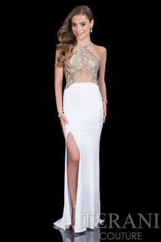 Stylish and chic, this dazzling evening dress from Terani 1615P1295 Barbie is a true beauty. The fashionable bib neckline bodice is edged in shimmering iridescent sequined designs and features sheer c