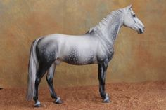 Cordes CM right (my favorite!) The mane and tail are mohair! I didn't even know until I read it!- Rogue Horse Studio