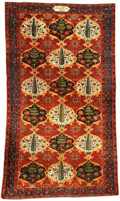 A Persian Bakhtiari carpet. The intricate patterns of these carpets add an exotic depth to any Victorian styled room.