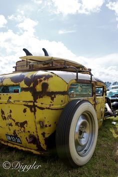 One mean-looking yellow #ratrod, by photographer Dirk Repper. It even has a rack for your surfboard.