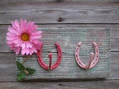Every little cowgirl will love this hat rack with 2 different color pink horseshoes and a pretty,glittery, pink flower!! Would look great in
