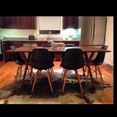 New #westelm #midcenturymodern dining table and #eames Eiffel chairs finally came in. #weinerdog sold separately