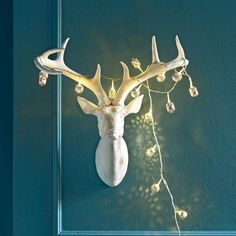 White Resin Stag. Can be painted different colors/stripes, etc. for different holidays/seasons...