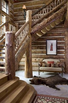 I designed the ultimate log cabin house in my head several years ago.....this is similar to what the staircase looked like - with a few modifications (of course)  :)  Nature inspired by  http://rinfretltd.designshuffle.com/portfolio/western-ranch/34403/