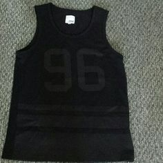"""NWOT 96 jersey Super cute! Was hoping to take it in and wear it as a dress but it didn't work out that way. Perfect for some jean shorts on a warm sunny day  41"""" around the waist 29"""" from top to bottom  Feel free to use the offer button on any items in my closet. elmwood  Tops"""