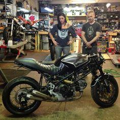 Ducati Monster custom with one-piece seat, black & bare metal tank