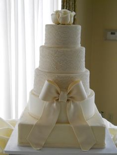 White Lace Wedding Cake minus the bow and with real flowers on top that match the bouquet