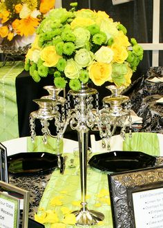 green and yellow wedding flower centerpiece.  Green and yellow roses filled in with button poms.