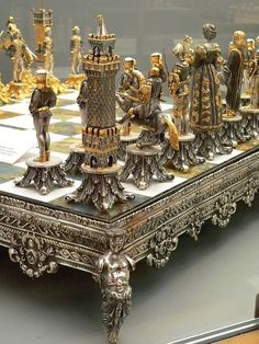 Silvered and Gilded Bronze Vasari Figural Chess Set rests on a board of silver framed polished Italian onyx Photographed at the Maryhill Museum of Art in Goldendale, Washington. Objets Antiques, Kings Game, Bronze, Chess Pieces, Board Games, Creations, Fancy, Cool Stuff, Decoration