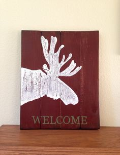 A personal favorite from my Etsy shop https://www.etsy.com/listing/251624043/distressed-moose-welcome-sign-rustic