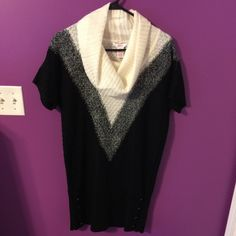 Long sweater Has been worn 1-2 times. Stretchy. 4 buttons down each of the sides. Great with tights! Candie's Sweaters