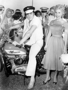 Elvis on his Harley 1956... don't know, but the woman in this photo looks a little like Holllywood Reporter May Mann.