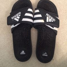 Adidas women's sliders Ridiculously comfortable, these sliders are a must have. Slight wear on the right heel, but other than that, perfect condition! Adidas Shoes Sandals