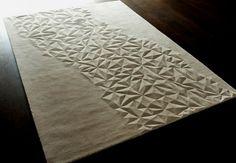 Geometrik taş vurgulu halı