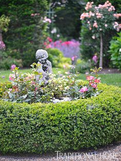 At the center of the Checkerboard Garden is a statue encircled by boxwoods. - Photo: Matthew Benson