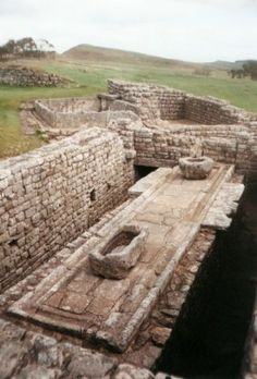 Roman toilets at Vercovicium Fort, a part of Hadrian's Wall in Northumberland, England.  The fort is now called Housesteads Roman Fort, and the latrines were for the fort's military garrison.