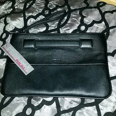 NWT Perlina Black Wristlet Clutch Highly sought after clutch that could also be used as a wristlet. This edgy yet classic accessory is perfect for a night out on the town. Lots of room for all your necessities. Leather with zip top closure and inside it has one zip and two open pockets.  Hold via Wristlet (as seen in picture ) or with the Front Handle. New with tags and shows no visible signs of wear. Measurements:12.5 x 8.25 x .25. Perlina Bags Clutches & Wristlets