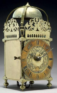 RARE CLOCK Brass and iron H.: 40 cm - W.: 18 cm France - In the seventeenth century condition, still has its weight of bronze
