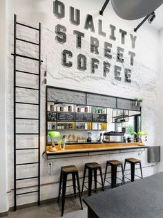 Andreas Petropoulos has recently completed the design of Daily Dose, a small takeaway coffee bar in the city of Kalamata, Greece, that features a white, black and wood interior. from contemporist Deco Pizzeria, Small Coffee Shop, Coffee Shops, Coffee Maker, Coffee Bar Design, Street Coffee, Small Cafe Design, Small Restaurant Design, D House