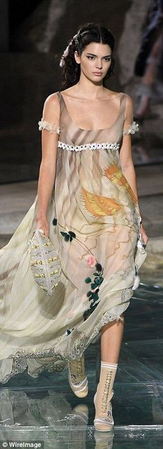Dramatic fashion moment: She also modelled a long taupe gown which was embroidered at the ...