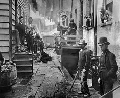 Around 1888, men gather in an alley called Bandits Roost in Manhattans Five Points neighborhood, the setting of the movie Gangs of New York. This and other Jacob Riis photographs inspired the city to raze the notorious Mulberry Bend block—and Bandits Roost with it.