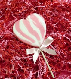 Pink heart-shaped swirl lolly.  Rock candy, favours, personalized sweets, wedding favours, edible, wedding rock sweets, sweets, rock sweets, customizable candy, sweet shop, sweetie, hen party, bridesmaid gift, wedding confectionery, Bonbonnier, party sweets, hard candy, unique gift, candy buffet, candy table, treats, winter wedding, summer wedding, spring wedding, autumn wedding, budget wedding, edible favour, unique wedding ideas Wedding Summer, Gift Wedding, Autumn Wedding, Wedding Favours, Candy Table, Candy Buffet, Personalised Sweets, Budget Wedding, Wedding Ideas