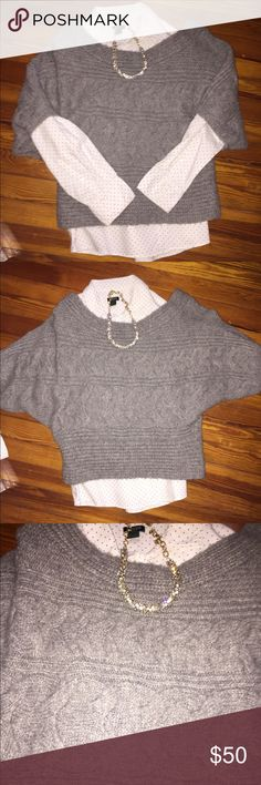 Free People Cropped Sweater Wide neck collar and cropped sweater that reaches the waist, grey in color by Free People. Perfect sweater to wear with jeans and riding boots. 69% acrylic/29% wool/1% spandex/1% other fiber Free People Sweaters