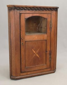 "18th c. English single inlaid door corner cupboard. Dental molded top. 31"" x 17"" x 40"" Ht.. Provenance: Richard Kyllo Collection New Jersey."