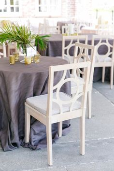 Steel Maxwell Linen with White Washed Circle Chairs | Modern Charleston Wedding at The Historic Rice Mill by Charleston Wedding Planner ELM Events