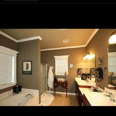 For bathroom, darker brown walls with lighter brown ceiling.  Brings out white trim and will work great with tan tile and off white cultured marble top.