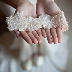 Pearl    This lovely romantic ivory lace wedding garter is adorned with exquisite soft ivory pearl beads.  Comes with a smaller lace toss garter with the same beading.