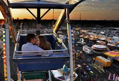 Lovers Esteban Armenta and Jessica Clark kiss while riding the Ferris wheel at the 60th annual Stock Show and Rodeo in San Antonio, Texas. #kiss #kisses #kissing #couple #love #passion #romance #fair